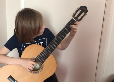 11 year old, Rendys Busevics plucks Phantom of the Opera by Andrew Lloyd Webber on the guitar