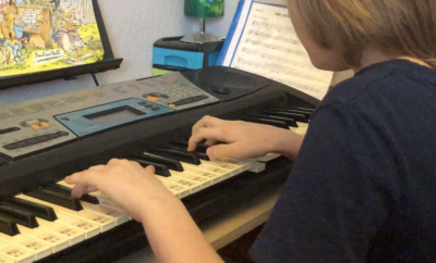 Rendys Busevics (aged 11) playing Bohemian Rhapsody by Queen on the piano